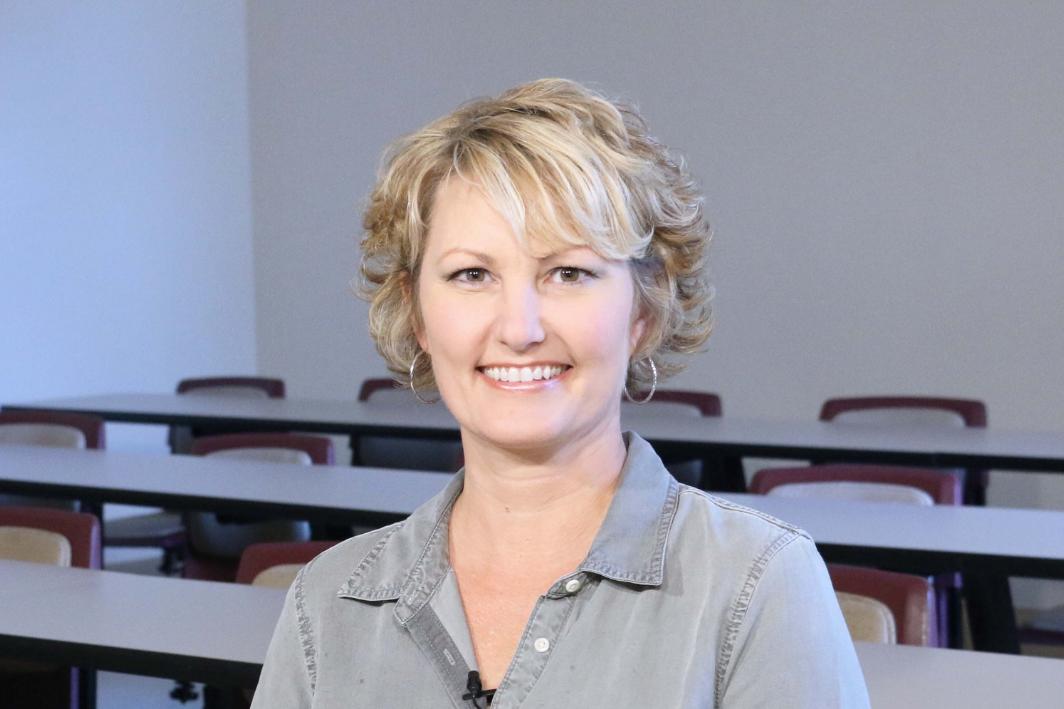 Debra smiling in classroom