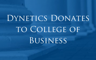 Dynetics presents check to Athens State University College of Business