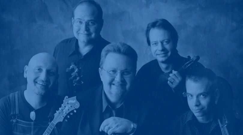 Nashville Bluegrass Band smiling with instruments